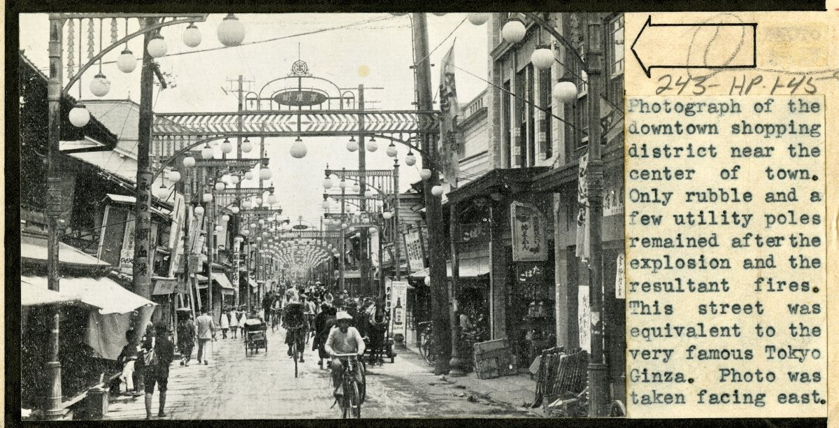 The downtown Hiroshima shopping district, c. 1945. After the bombing, only rubble and a few utility poles remained.