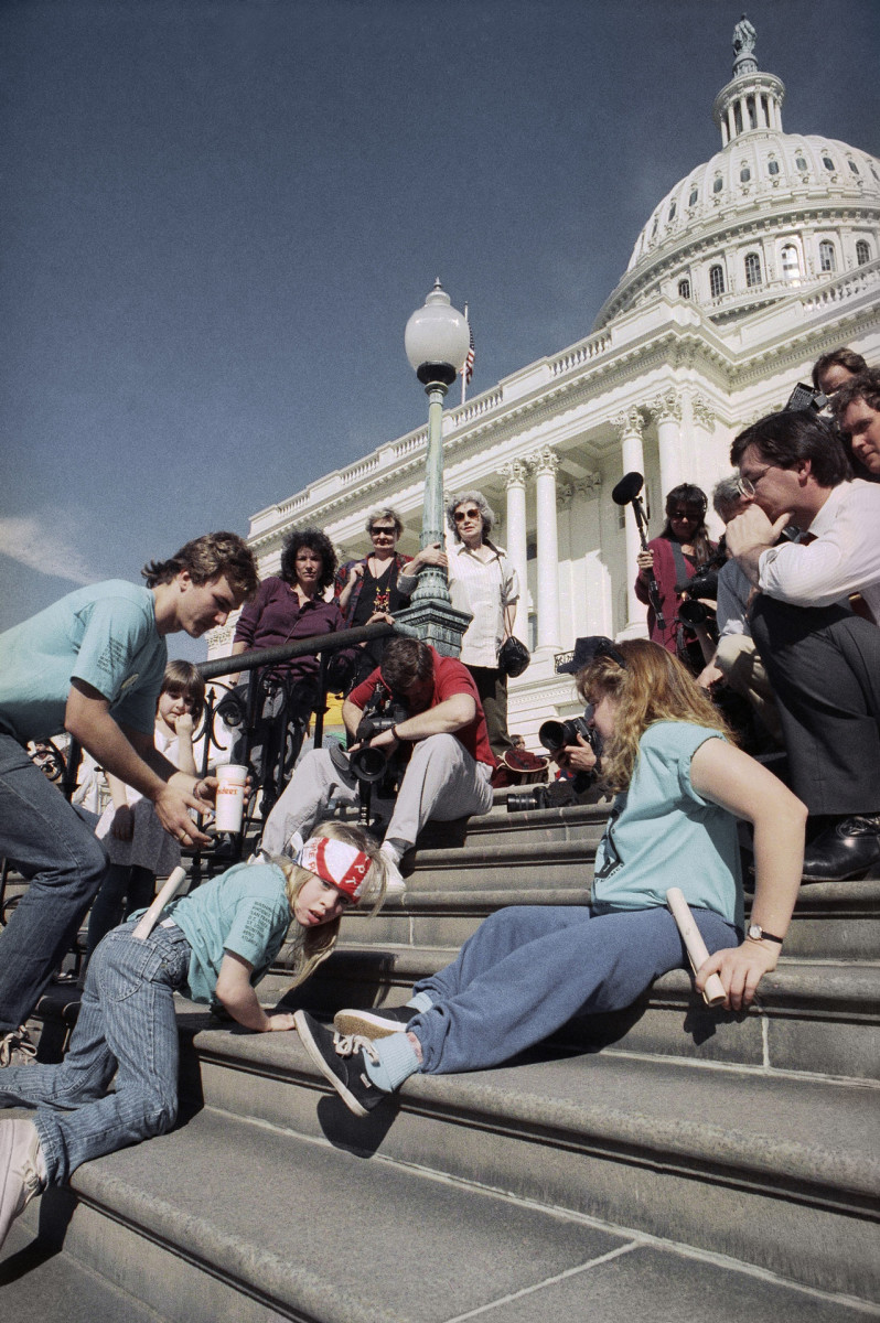 A group of handicapped people led by 8-year-old Jennifer Keelan crawl up the steps of the U.S. Capitol in Washington, to draw support for a key bill pending in the House that would extend civil rights to disabled persons.