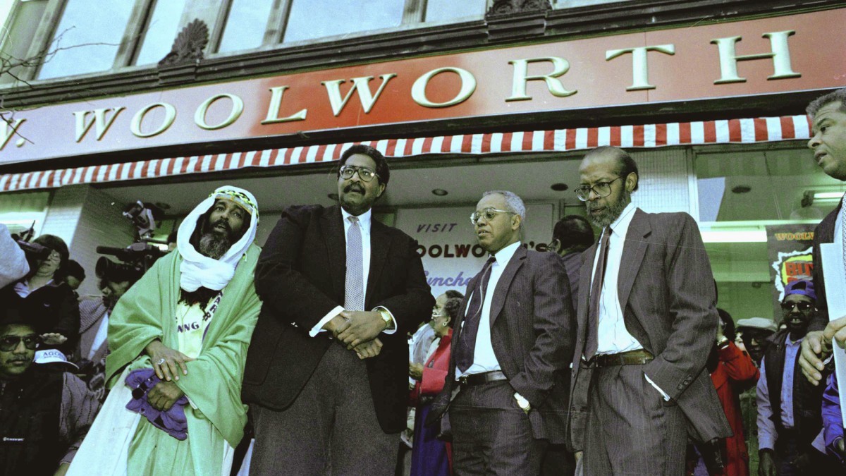 The four men who were denied service at a Woolworth store in Greensboro, North Carolina, pose in front of the store on February 1, 1990. From left to right: Jibreel Khazan (formerly Ezell Blair, Jr.), Franklin McCain, Joseph McNeill, and David Richmond.