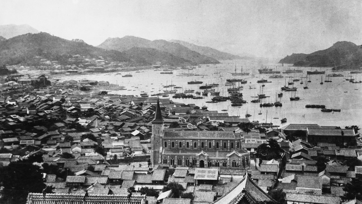 The harbor at Nagasaki, Japan, c. 1920. A Christian church can be seen in the foreground.