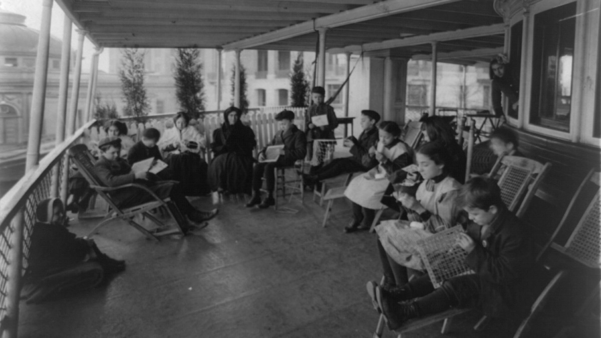 Open-air class in manual training on the boat Southfield at Bellevue Hospital in New York City, which transformed ferry barges into floating wards to battle tuberculosis.