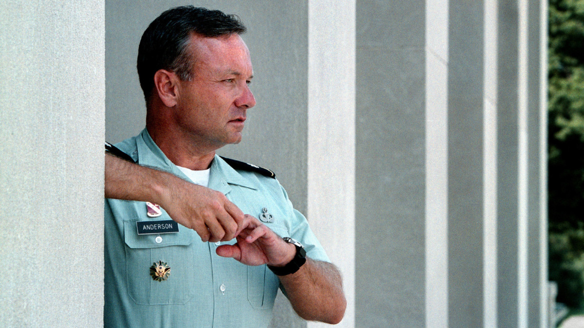 "Col. Paul ""Ted"" Anderson stands outside the Pentagon, glancing at planes leaving National Airport, in August 2002."