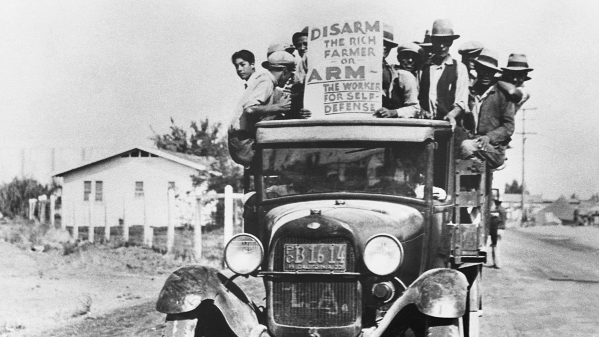 A group of Mexican farm workers protest from the back of a truck during a strike in California, 1933.