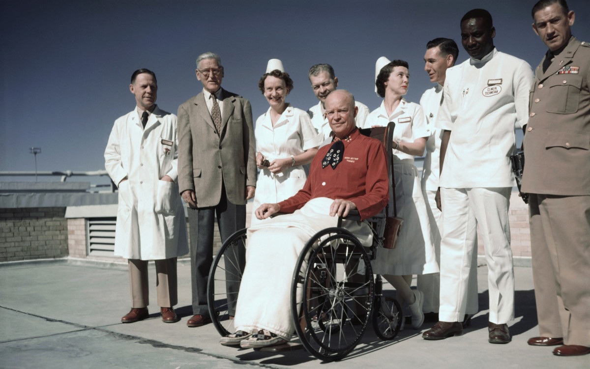 President Eisenhower poses for first pictures since he was stricken with a heart attack.