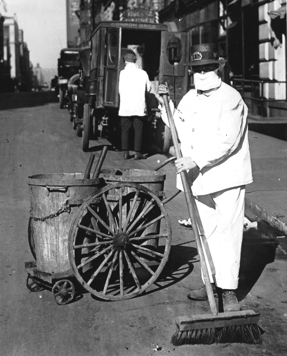 A New York city street sweeper wears a mask during the influenza epidemic, October 1918.