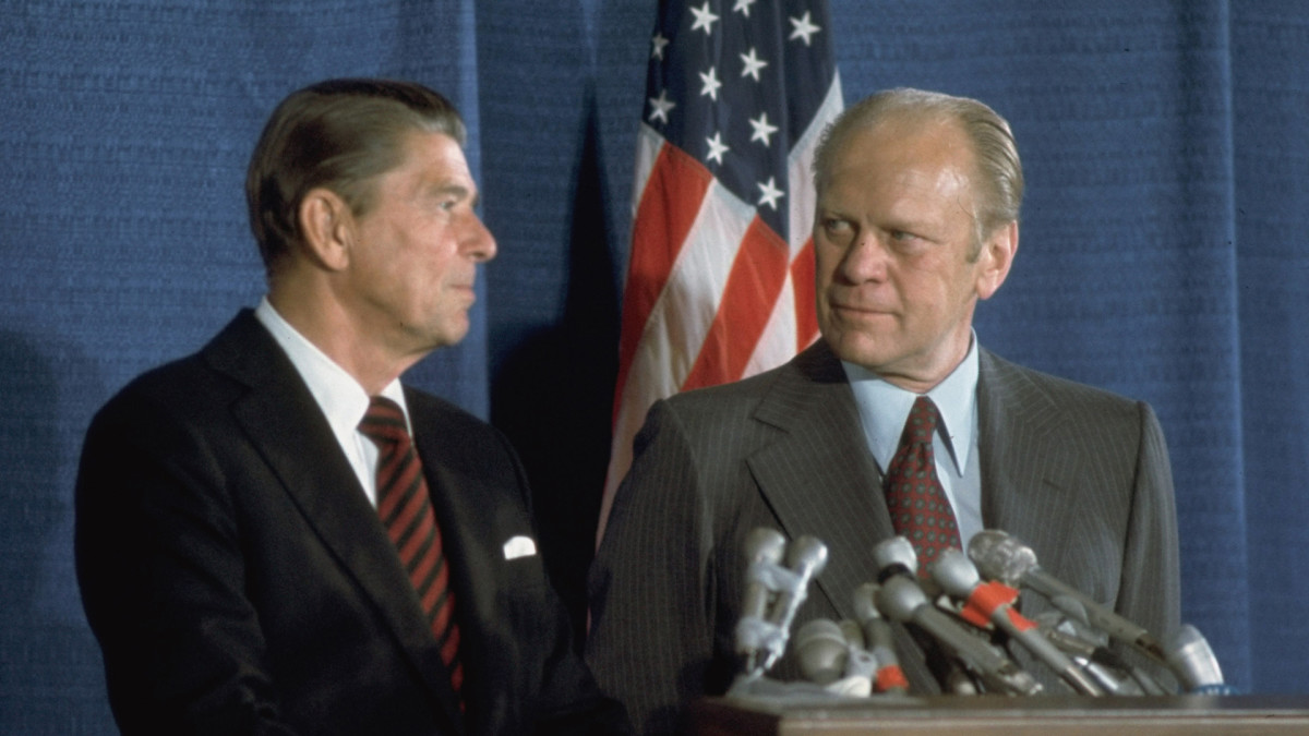 Then-candidate Ronald Reagan and President Gerald Ford eye each other at a podium during the GOP National Convention in Kansas City, Missouri, August 1976.