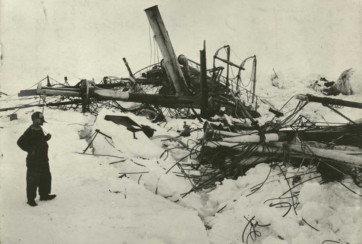 Explorer Frank Wild (1873 - 1939) looking at the wreckage of the Endurance, 1915.