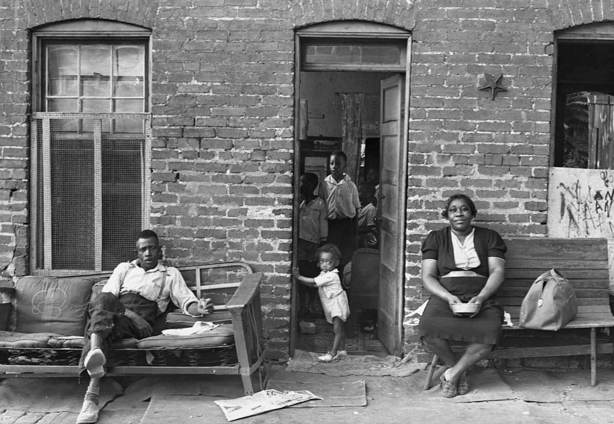 A Black family in a poor section of Washington, D.C., 1937.