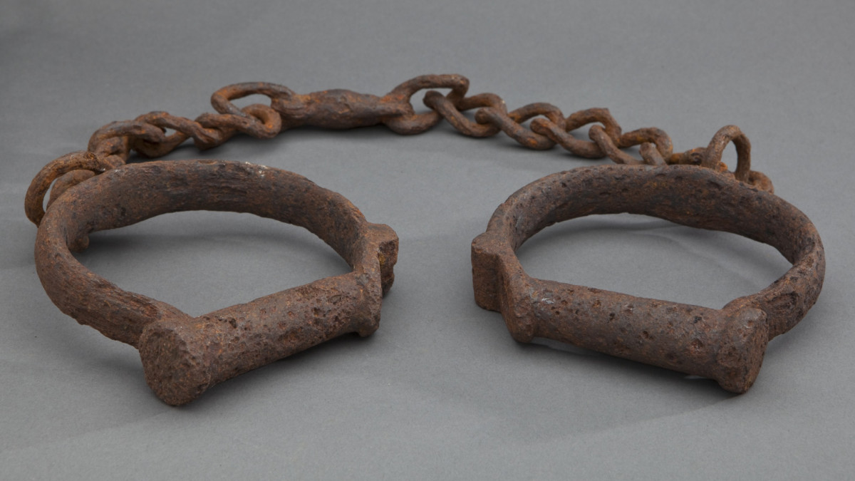 Iron shackles, dated pre-1860.