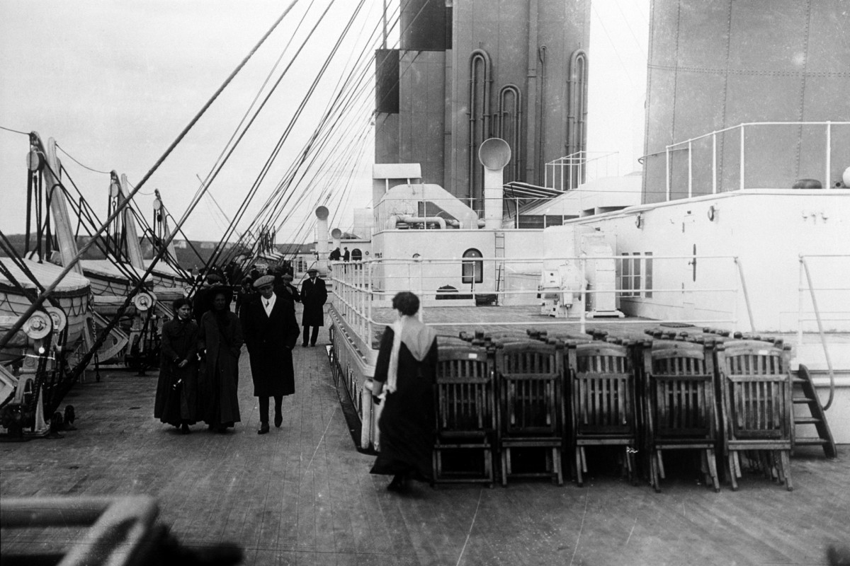 Passengers walk on the deck of the SS Titanic, 1912.