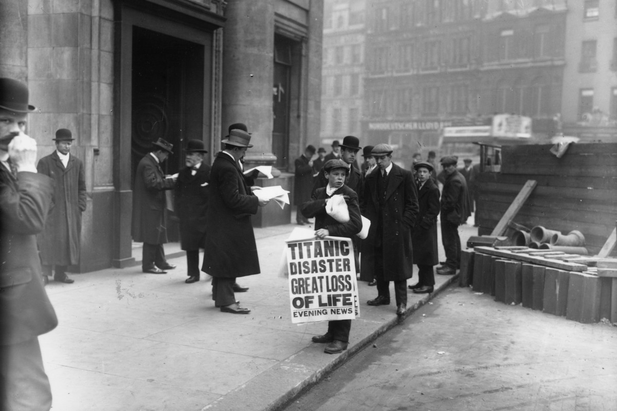 London, April 16, 1912: Newspaper boy Ned Parfett sells copies of the Evening News, telling of the Titanic maritime disaster, outside Oceanic House, the London offices of the Titanic's owner, the White Star Line,