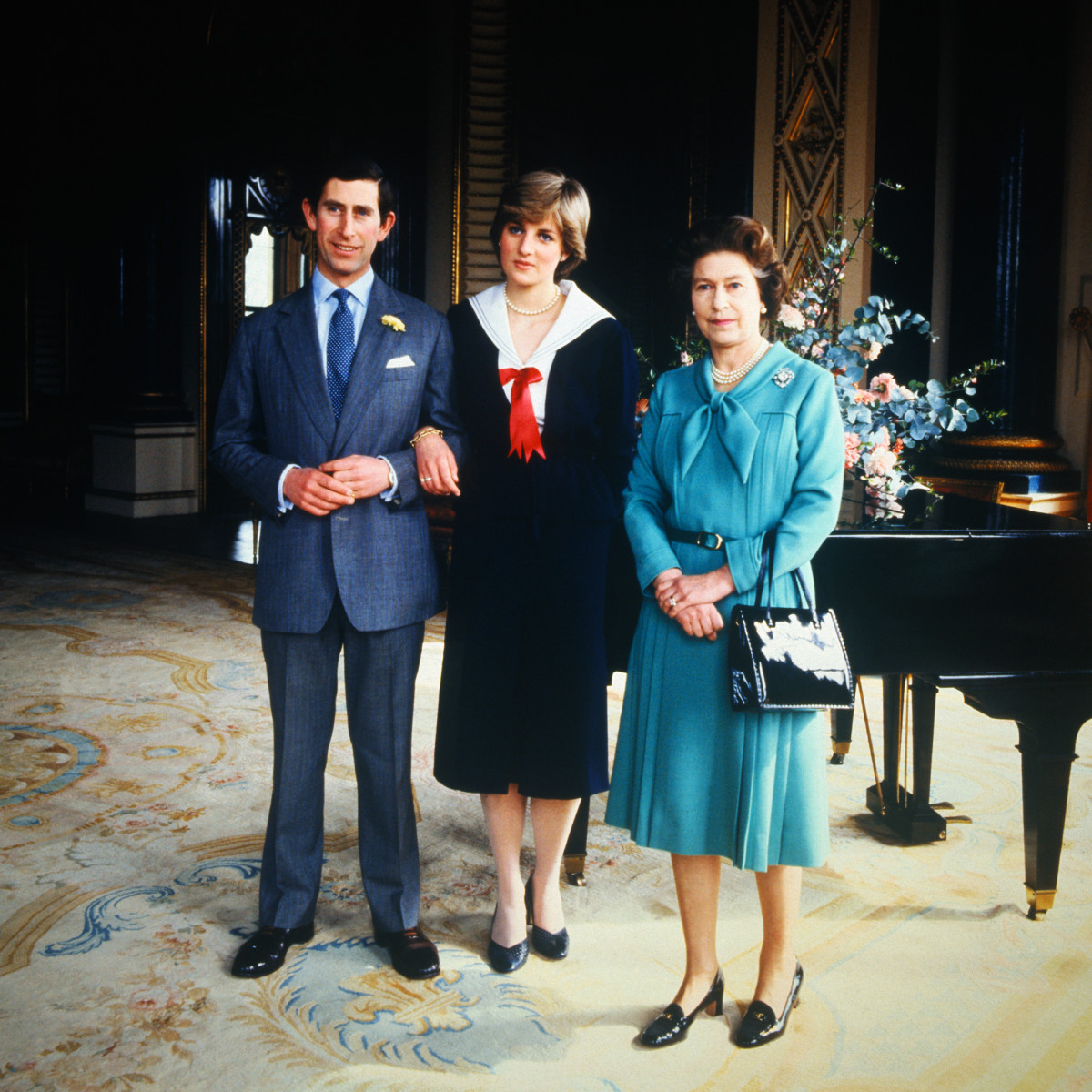 After the Privy Council sanctioned their wedding, Lady Diana Spencer and Prince Charles pose with Queen Elizabeth at Buckingham Palace, in March 1981.