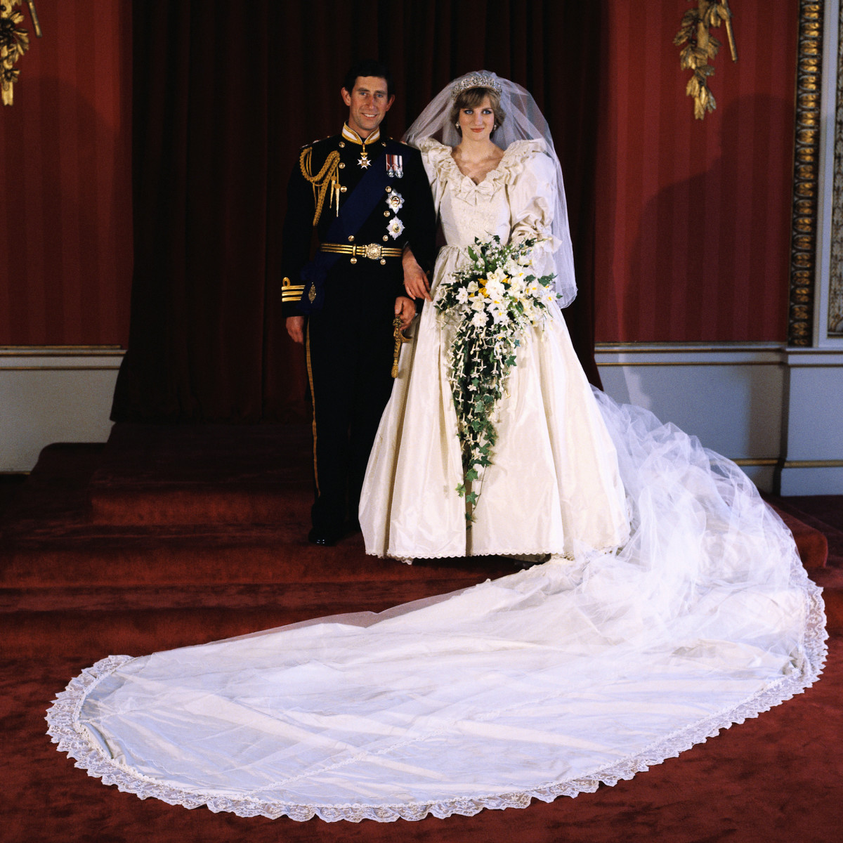 Diana, Princess of Wales and Prince Charles pose for the official photograph by Lord Lichfield in Buckingham Palace at their wedding.