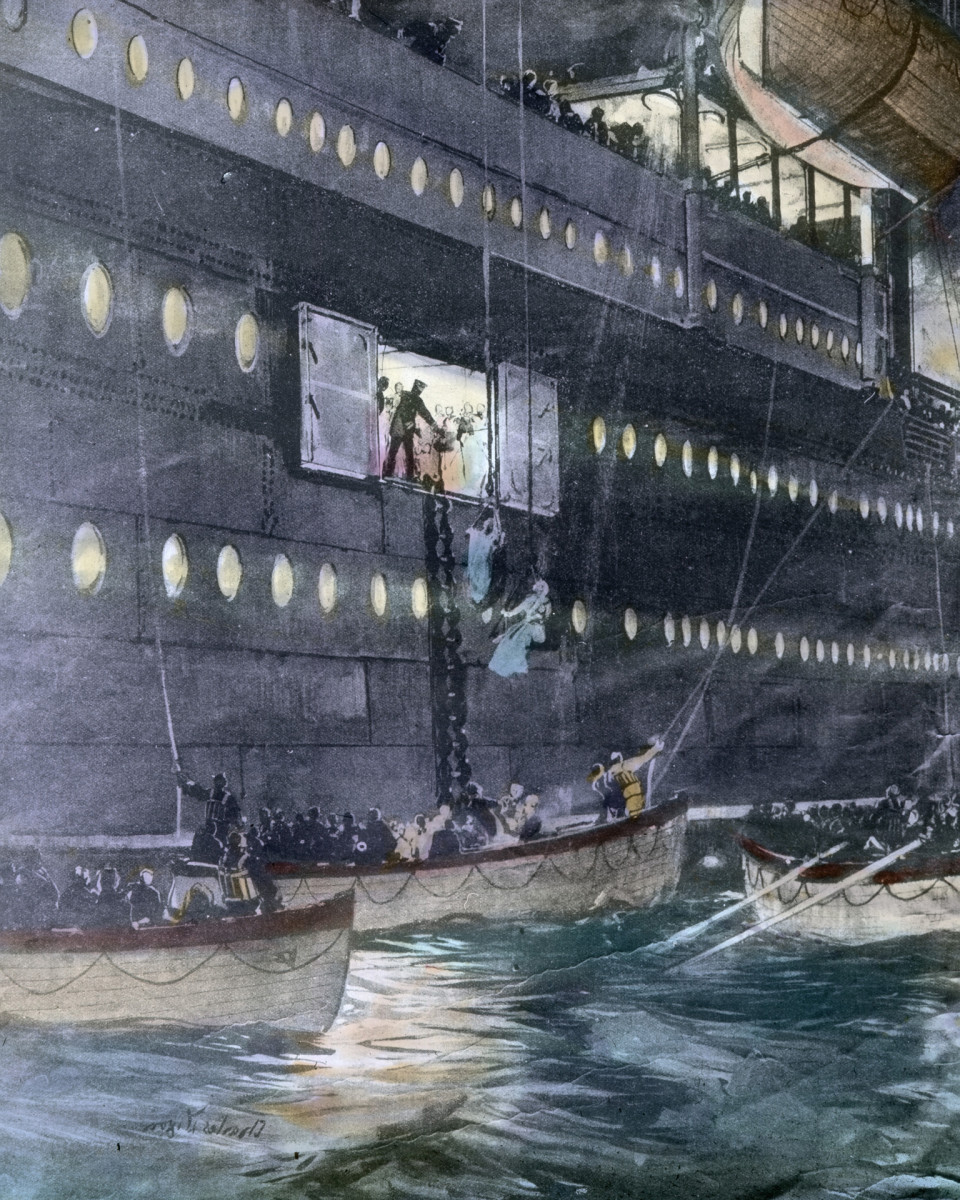 Titanic lifeboats being lowered into the water