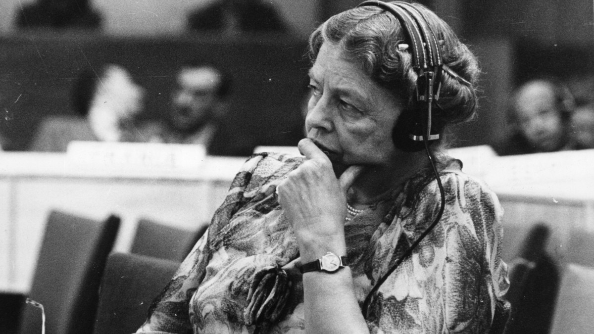 Eleanor Roosevelt, humanitarian, widow of Franklin D. Roosevelt and representative to the United Nations, listens through headphones during a conference at the temporary UN headquarters at Lake Success, New York, 1946.