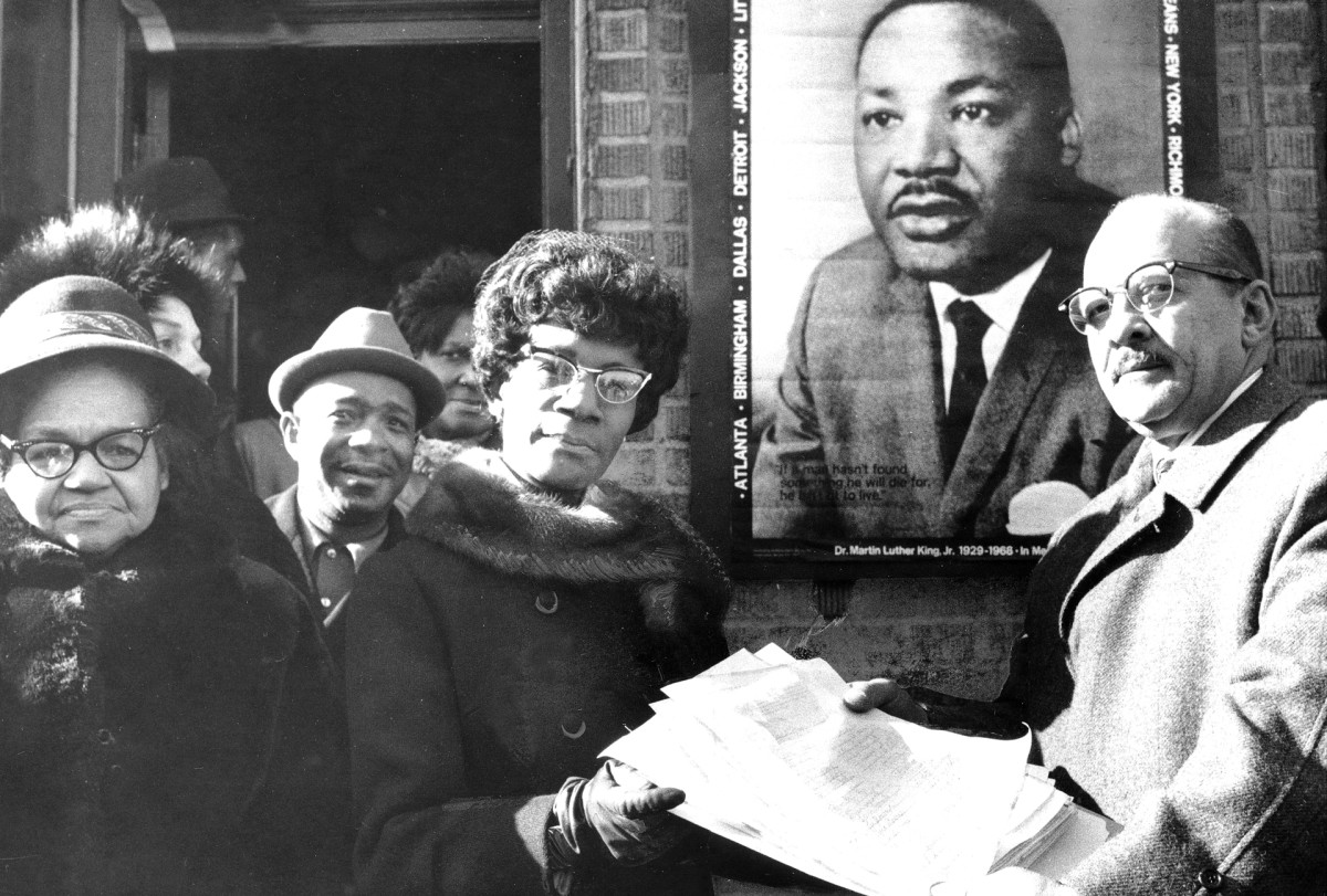 Rep. Shirley Chisholm receives petitions asking Congress to designate January 15, a national holiday in honor of Martin Luther King, Jr.