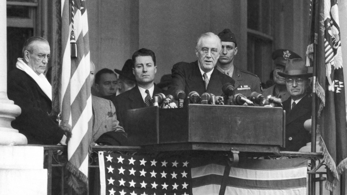 Vice President Harry S. Truman sitting in background as President Franklin D. Roosevelt makes his inaugural address, January 20, 1945.