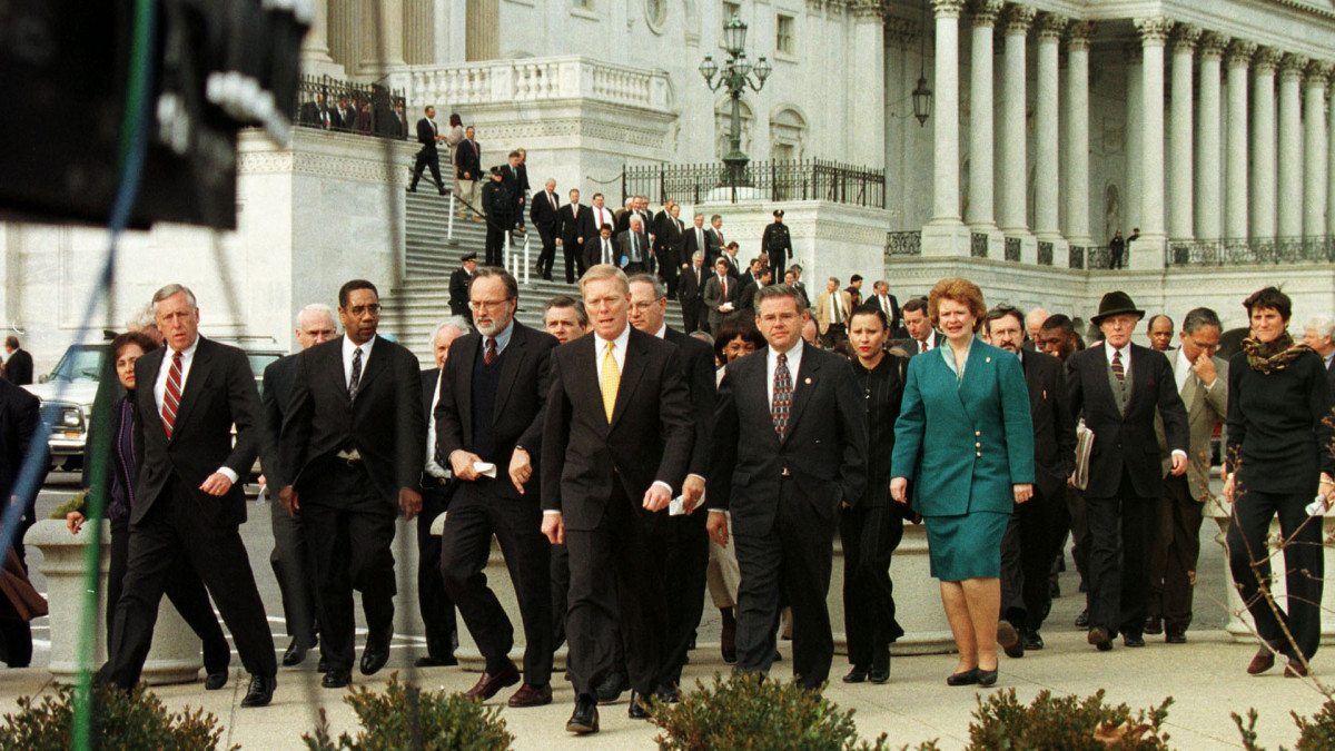 Democratic Leader Richard Gephardt walks out of the House Chambers with a large group of Democrats after marching out of the House chamber briefly to protest the Republicans' refusal to allow a vote on the lesser punishment of censure against President Bill Clinton, December 19, 1998.