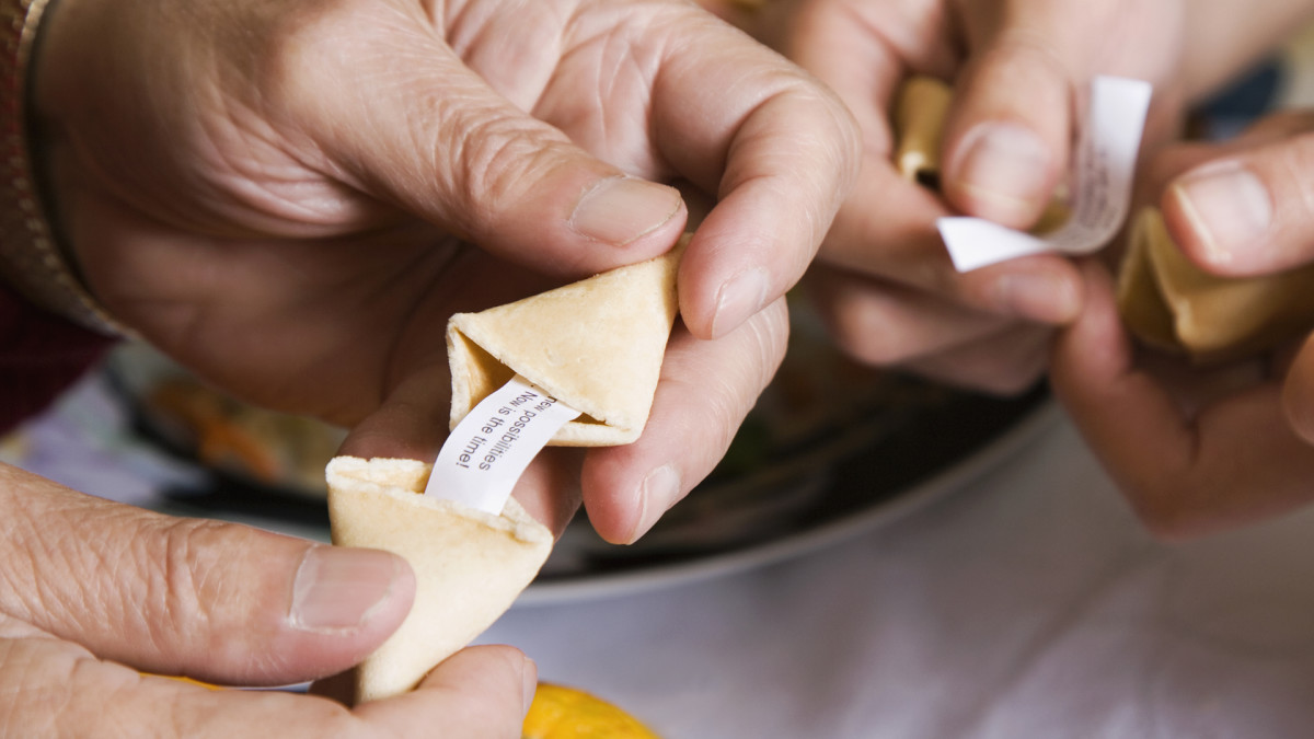 A family opening fortune cookies.