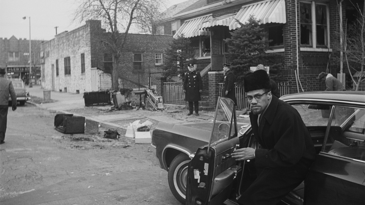 Malcolm X gets out of his car at his house, which had been firebombed the night before, almost certainly by his former colleagues in the Nation of Islam, on February 15. In a week's time, Malcolm X would be assassinated.