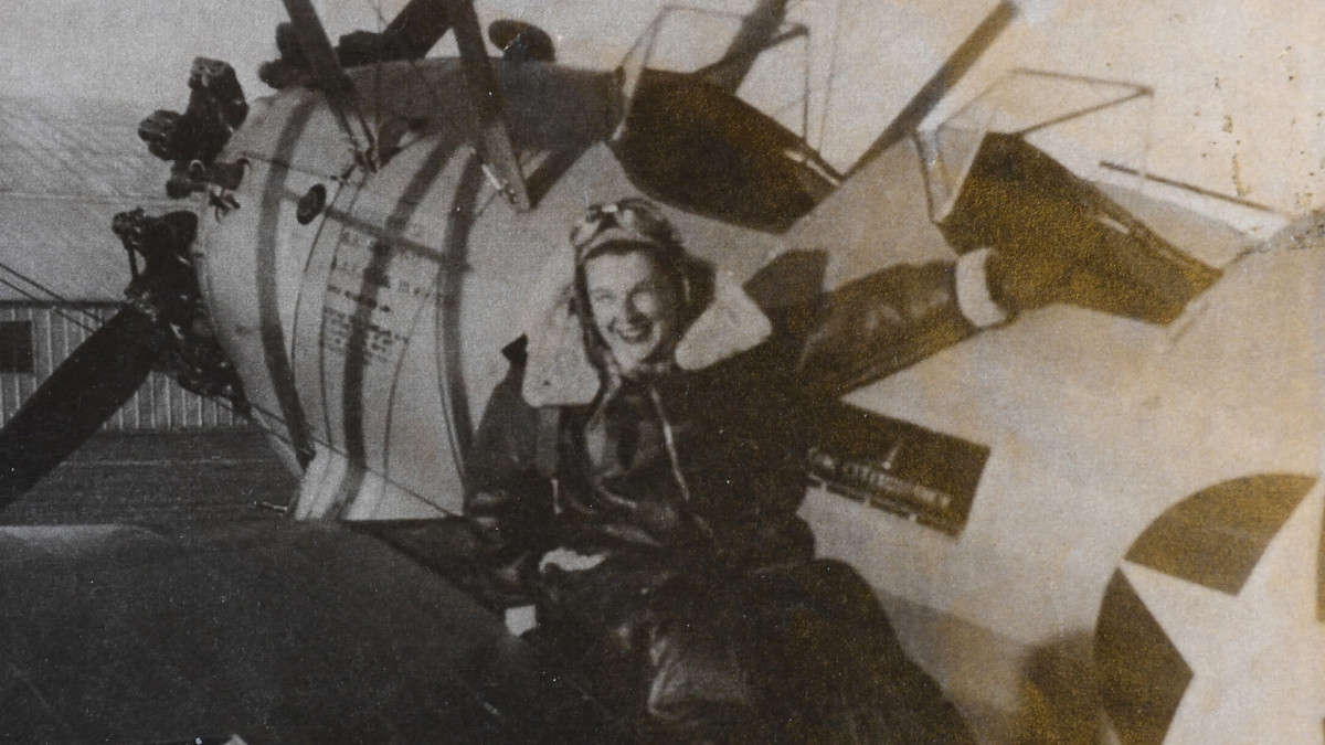 Jane Tedeschi next to one of the aircraft she flew during WWII with the Women Airforce Service Pilots (WASPs), a group that performed aviation services stateside, covering for the male pilots deployed to the WWII battlefront. She was one of about 1,100 female pilots who moved planes and towed target aircraft for live-fire drills.
