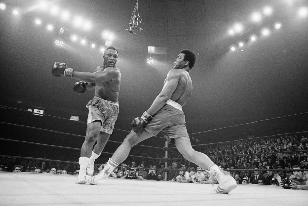 Muhammad Ali steps away from a punch thrown by boxer Joe Frazier during their heavyweight title fight at Madison Square Garden in 1971.