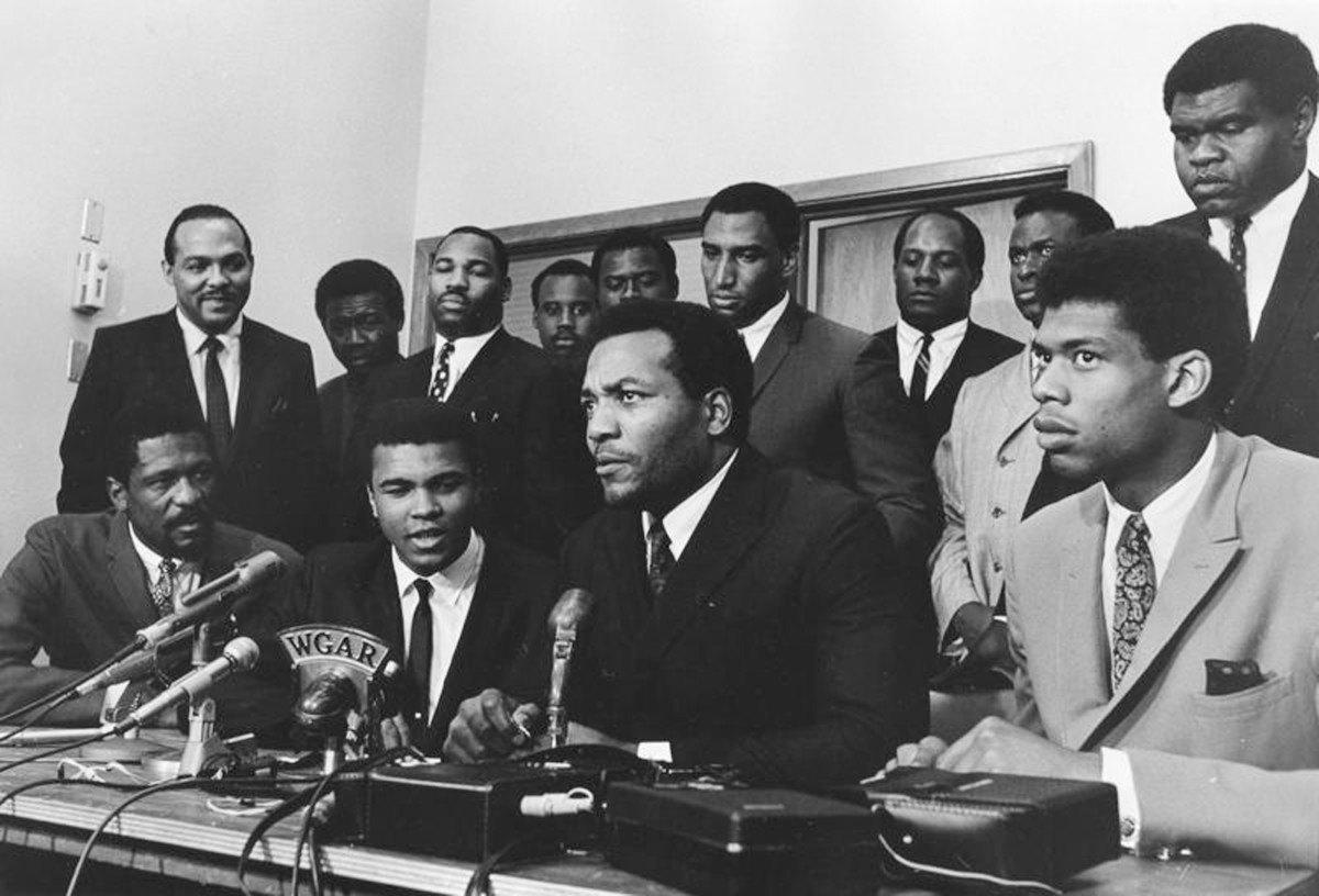 Ali (first row, second from left) and a group of top African American athletes from different sporting disciplines gather to give support and hear the boxer give his reasons for rejecting the draft.