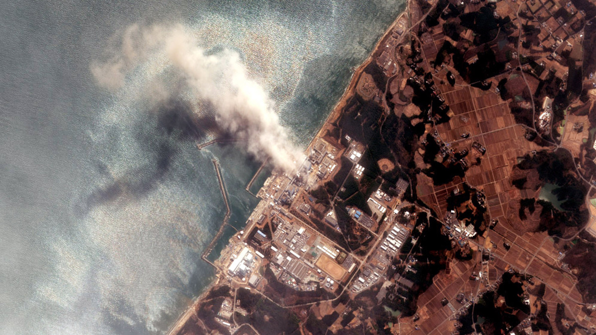 In this satellite view, the Fukushima Dai-ichi Nuclear Power plant after a massive earthquake and subsequent tsunami on March 14, 2011. Japanese officials report that a fire at the stricken Fukushima nuclear power plant has released radioactive material into the air in the latest development in the chaos wrought by the recent earthquake and tsunami that have left at least 10,000 people dead in northeastern Japan.