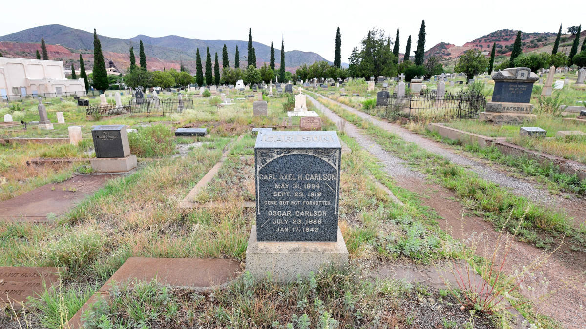 The grave of Army Private Carl Axel Carlson, who died of the 1918 influenza pandemic, is seen among others who met a similar fate at a cemetery in Bisbee, Arizona. The train that carried his body home to Bisbee brought the deadly flu with it.