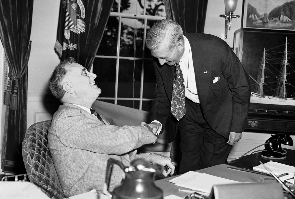 William Knudsen, president of General Motors, meeting with President Franklin D. Roosevelt at the White House for the first meeting about the new National Defense Advisory Commission. Knudsen traded his high-paying auto-executive job for a $1 government salary to help lead Detroit's war-production effort.