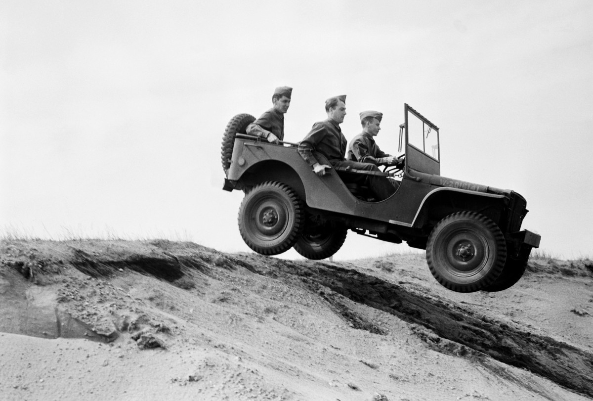 A Bantam jeep negotiates rough terrain. Jeeps have been called the grandfather of all SUVs.