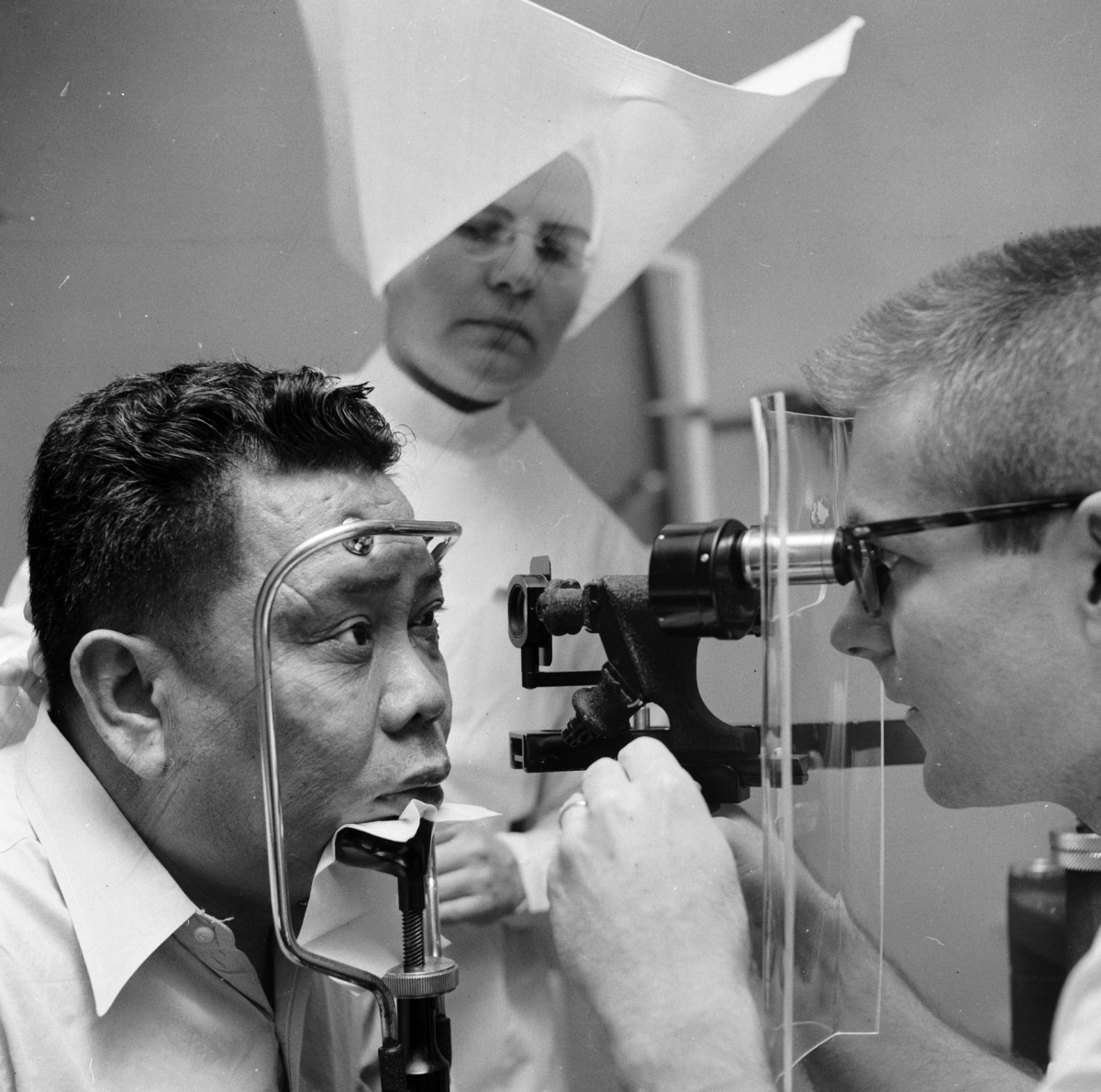 A patient at the US Public Health Service Hospital, in Carville, Louisiana, having his eyes examined, 1955. This hospital for leprosy sufferers was for many decades run by nuns.