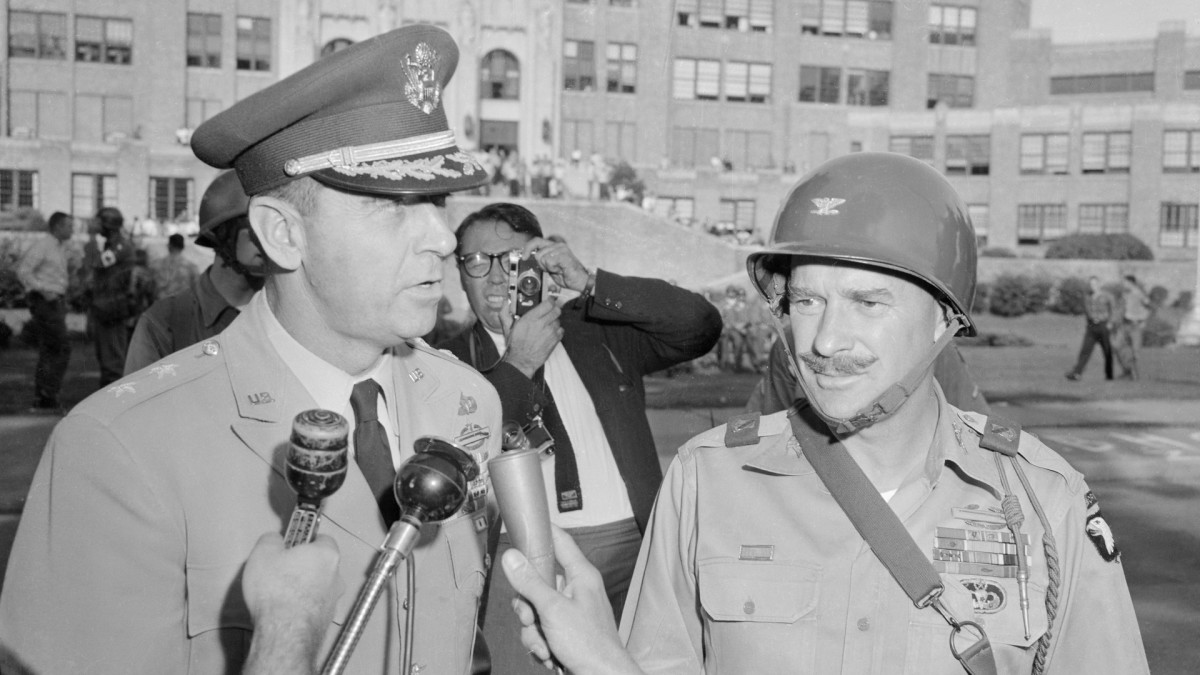Major General Edwin A. Walker, (left), the Commander of the federal troops on duty at Little Rock in 1957, talks to reporters with Col. William A. Kuhn at his side, on September 25, 1957. Kuhn was in charge of the 327th Airborne Battle Group that guarded Central High School at the height of the crisis.