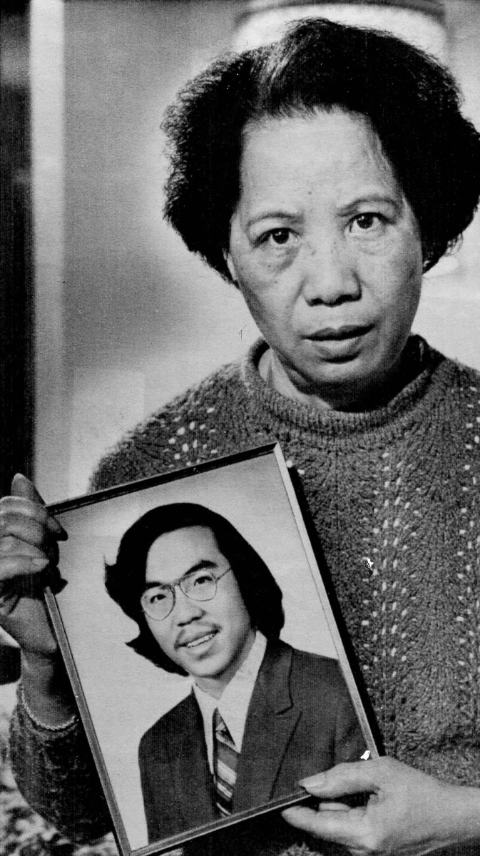 Lily Chin holds a photograph of her son Vincent, 27, who was beaten to death on June 23, 1982.