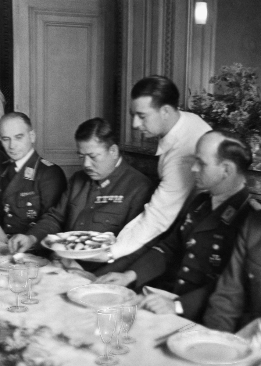 Japanese general Tomoyuki Yamashita seated between German officers during his visit to the 53rd German Bomber Wing, near Calais, France, part of his clandestine tour of Nazi World War II military operations.