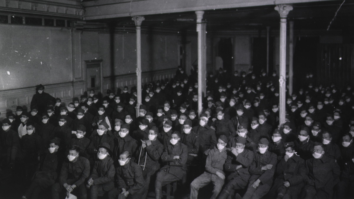 Patients at U. S. Army Hospital No. 30 at a movie wear masks because of an influenza epidemic.