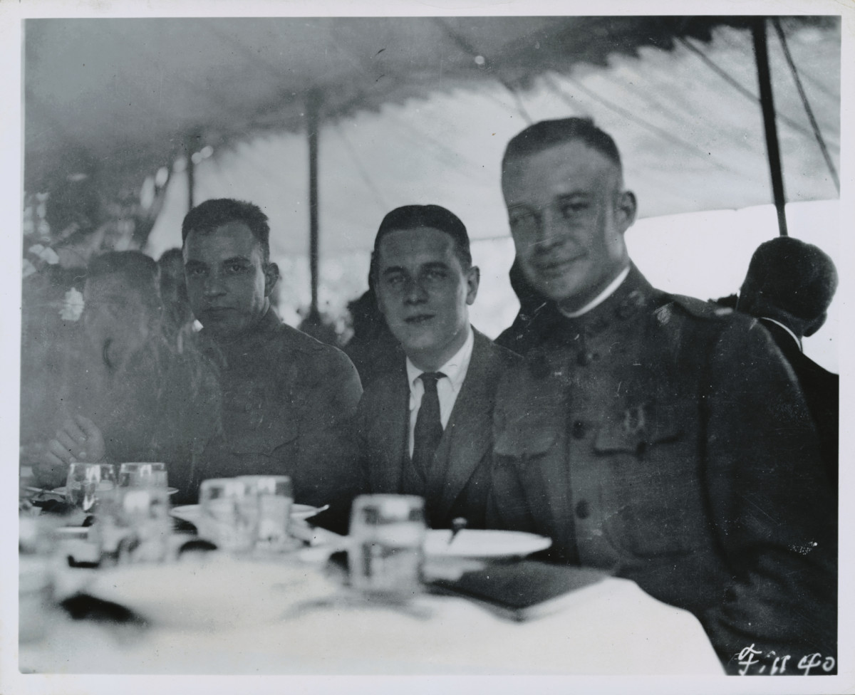 Lieutenant Colonel Eisenhower (right), second in command of the Army's first transcontinental motor truck convoy, stopping for a chicken dinner on the lawn at the Firestone Homestead Farm in Ohio, on July 13, 1919.