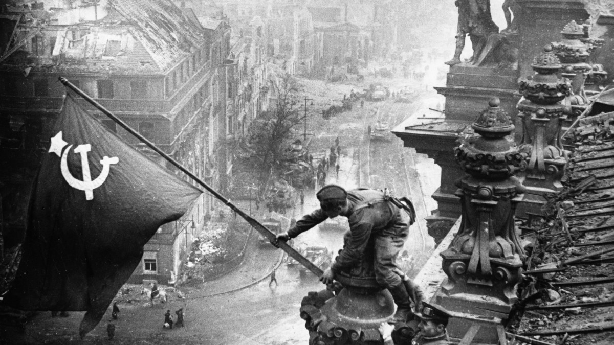 Red Army soldiers raising the Soviet flag over the Reichstag in Berlin, on May 2, 1945.