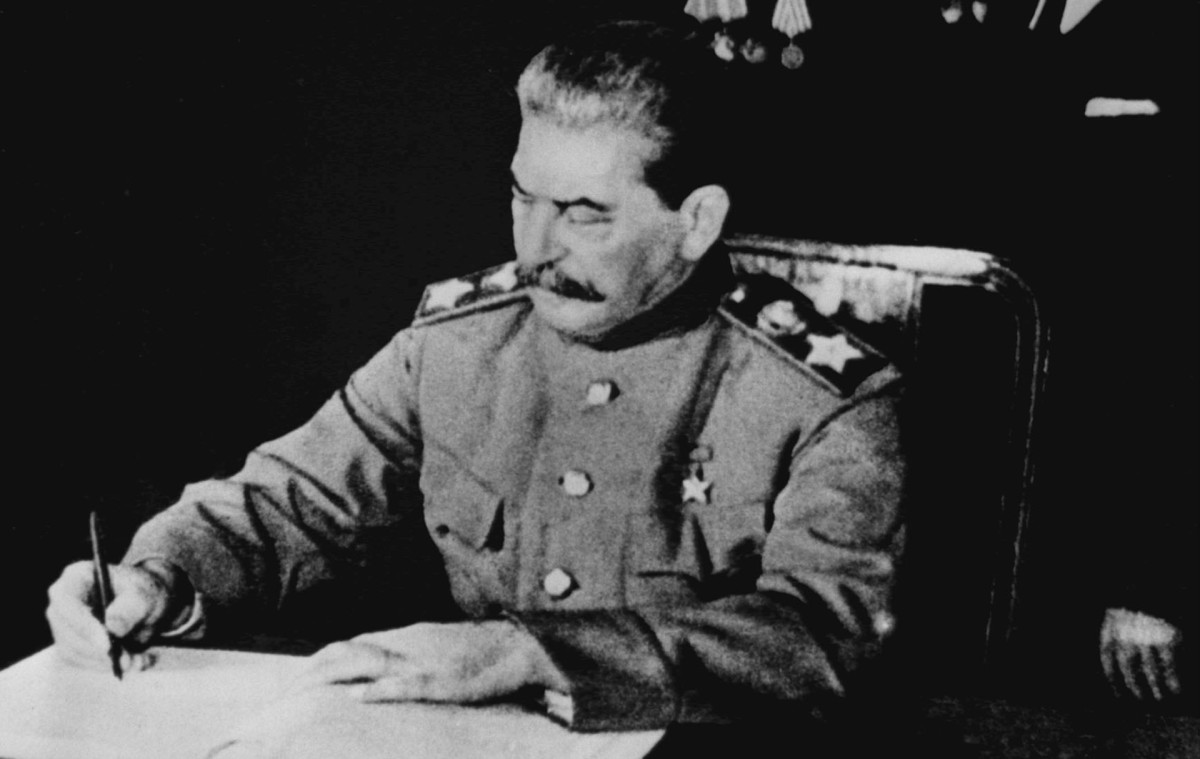 Joseph Stalin signing a treaty of friendship and mutual assistance between the USSR and Poland, April 21, 1945.