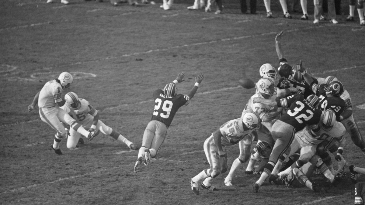 In Super Bowl VII against Washington, Garo Yepremian's field goal attempt was blocked. The kicker picked up the ball and threw it, but it was caught by Mike Bass, who ran it back for a touchdown.