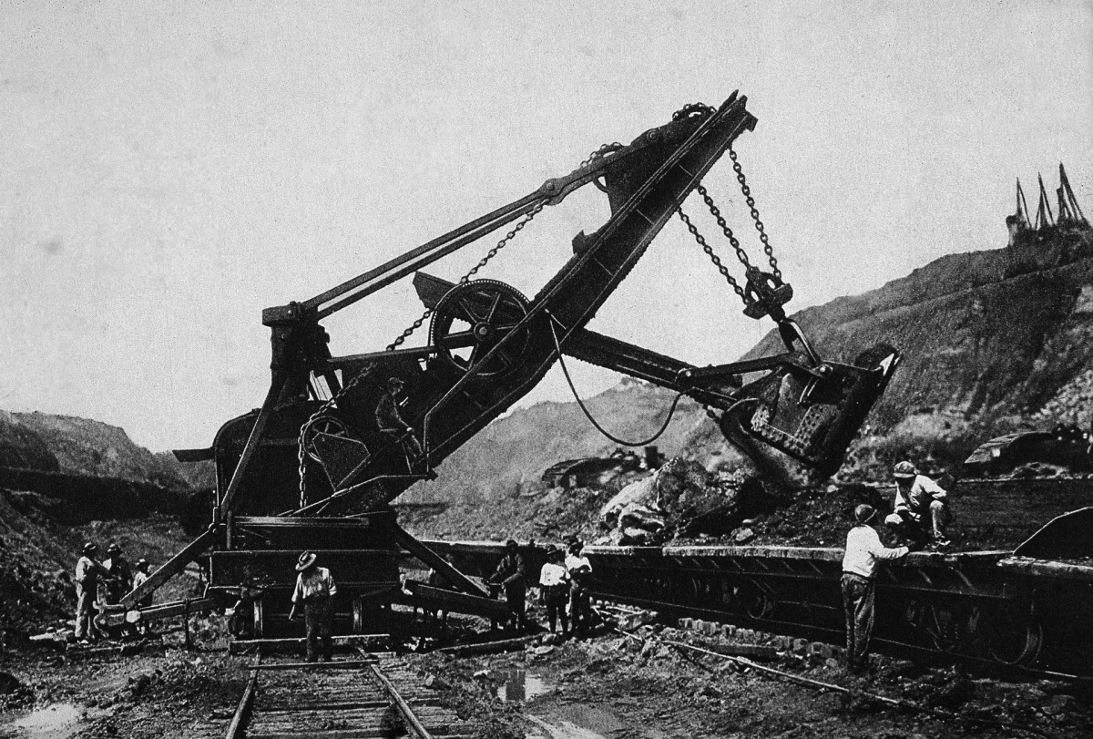 A shovel vehicle operates during the construction of the Panama Canal, c. 1906.