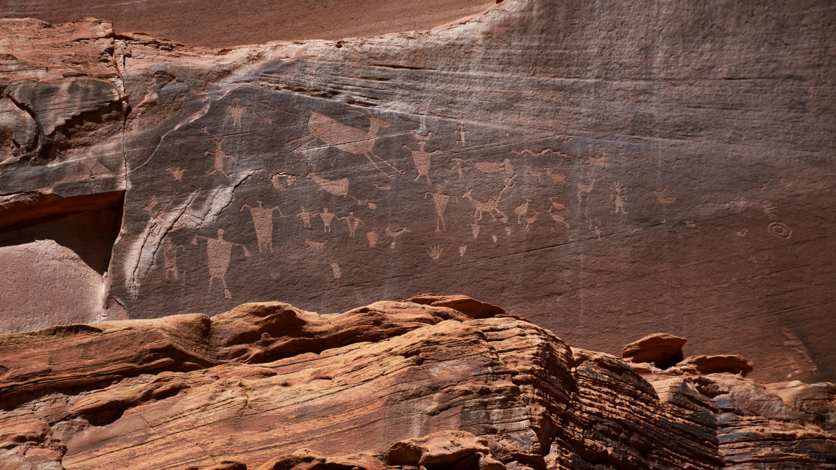 Ancient petroglyphs are etched into the stone walls at Canyon de Chelly National Monument near Chinle, Arizona.