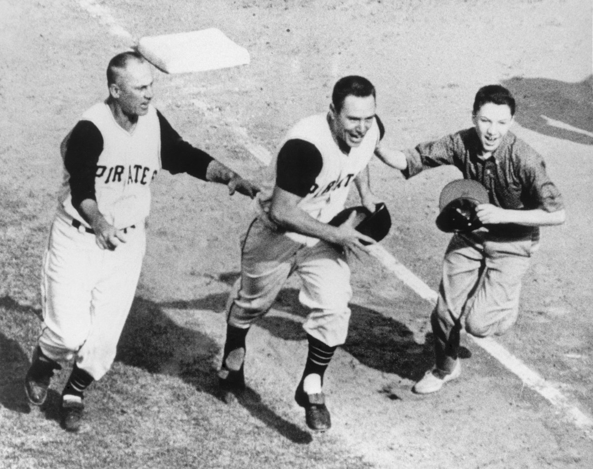 Pittsburgh's Bill Mazeroski rounds third after hitting the home run that beat the Yankees in Game 7 of the World Series, 10-9.