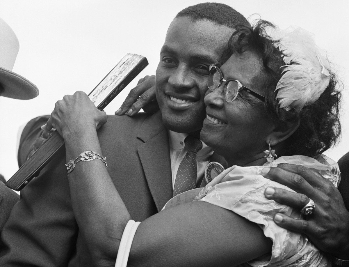 Roberto Clemente hugs his mother at the San Juan airport in 1961, the year he won the National League batting title.
