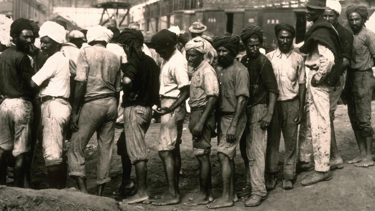 Workers waiting in line for their pay at the Culebra Cut, formerly called Gaillard Cut,an artificial valley that cut through the continental divide in Panama.