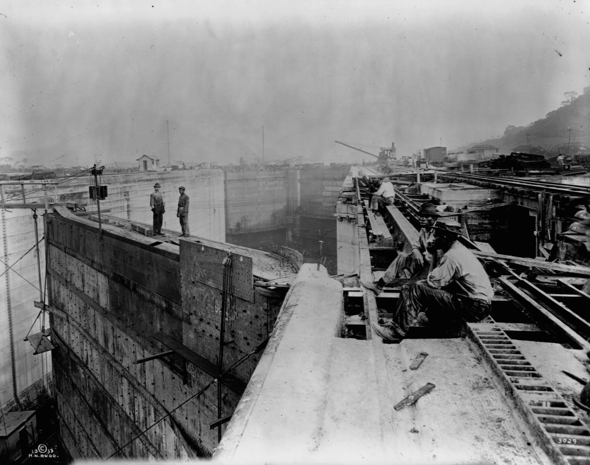 Workers take a break at a construction site, possibly canal locks, during the construction of the Panama Canal, 1913.