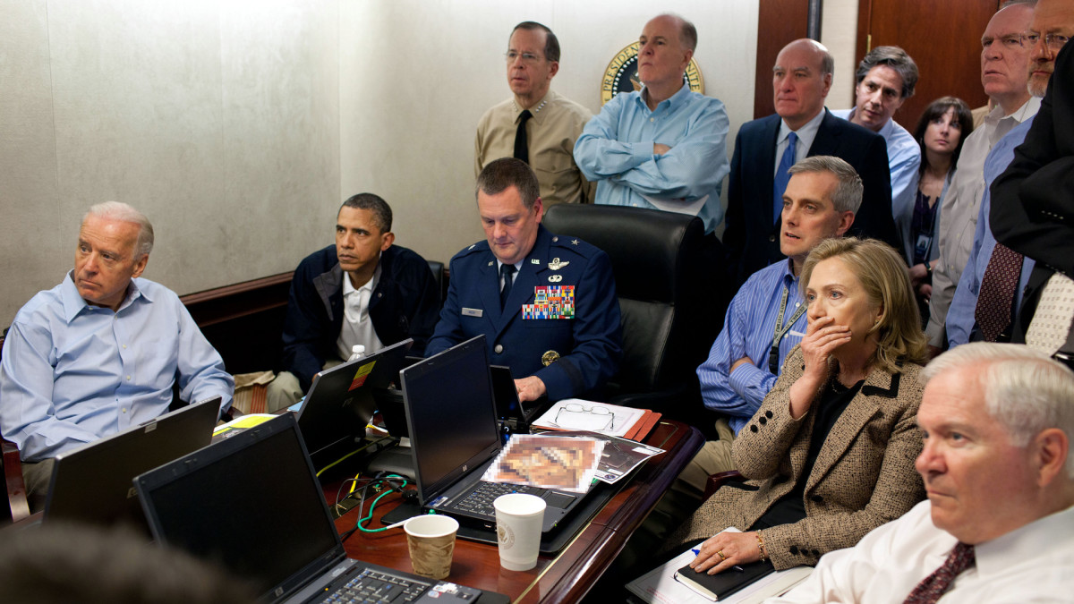 President Barack Obama, Vice President Joe Biden, Secretary of State Hillary Clinton and members of the national security team receive an update on the mission against Osama bin Laden in the Situation Room of the White House May 1, 2011, Washington, D.C.
