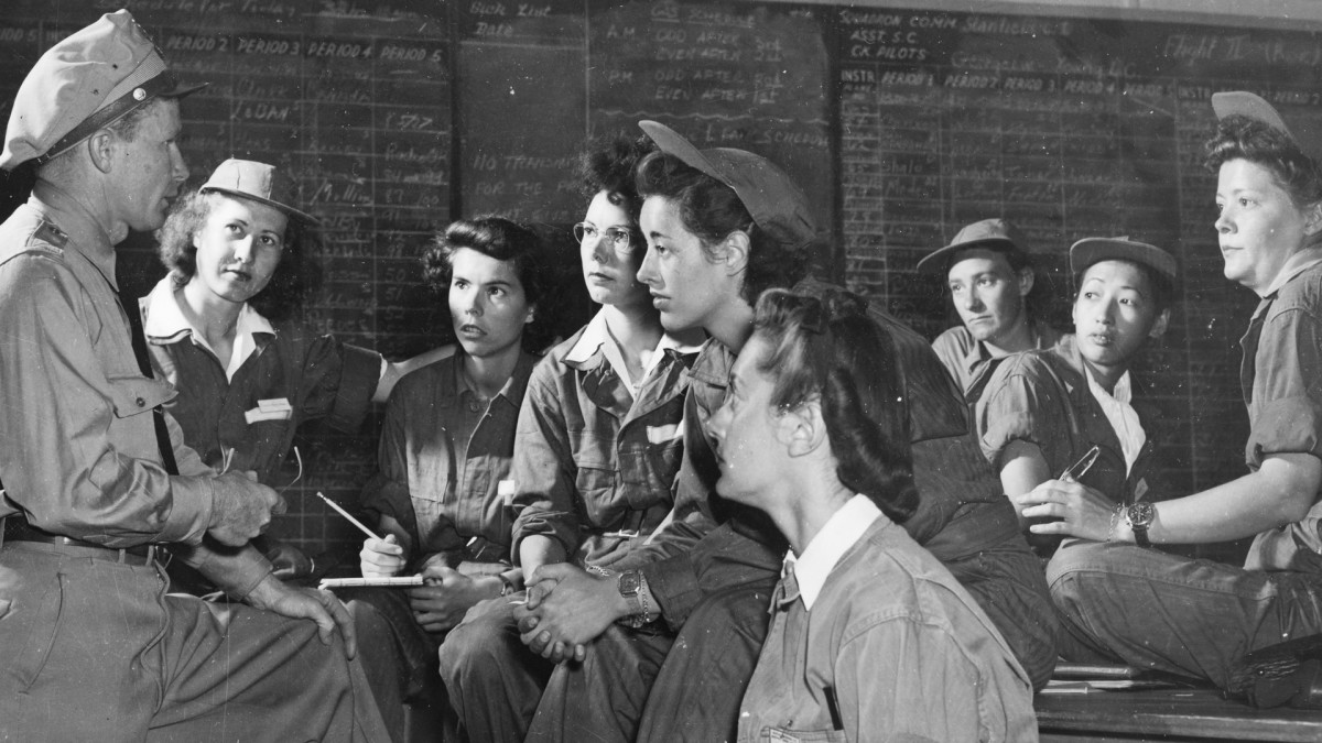 Group Commander Charles Sproul briefs a group of Women's Air Force Service Pilots (WASPs) at Avenger Field in Sweetwater, Texas, May 1943. Pictured are, fore, from left: Sproul, Irma Cleveland, Faith Buchner, Martha Lundy, Mary Jane Stevens, and Annabelle Kekic; back row, seated from left: trainees Ruby Mullins, Hazel Ying Lee, and Virginia Harris Mullins.