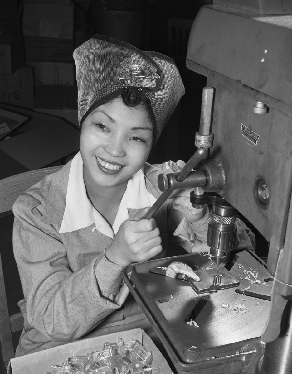 Sallie See Moi Choi, a Honolulu-born Chinese American assisting the war effort in a Los Angeles defense plant. She is shown here operating a drill, 1943.