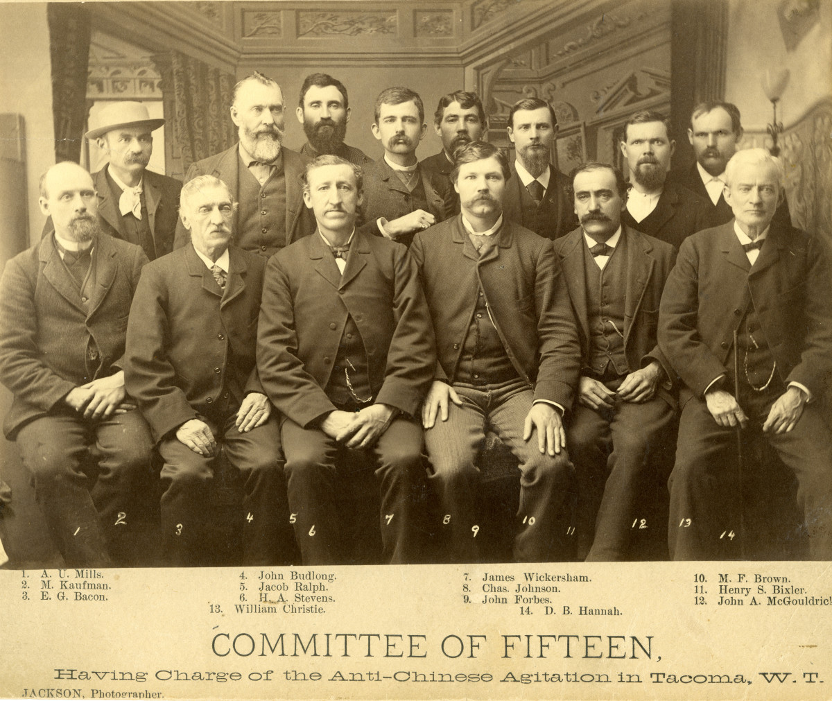 1885 group portrait of 14 members of the Committee of Fifteen, who were in charge of Anti-Chinese Agitation in Tacoma, Pierce County, Washington Territory.